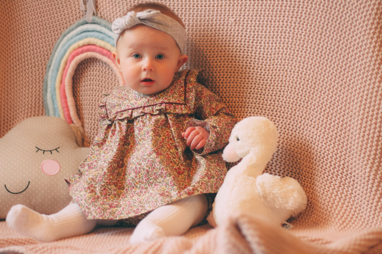 La Coqueta Spanish baby clothes review - baby girl wearing frilled floral dress